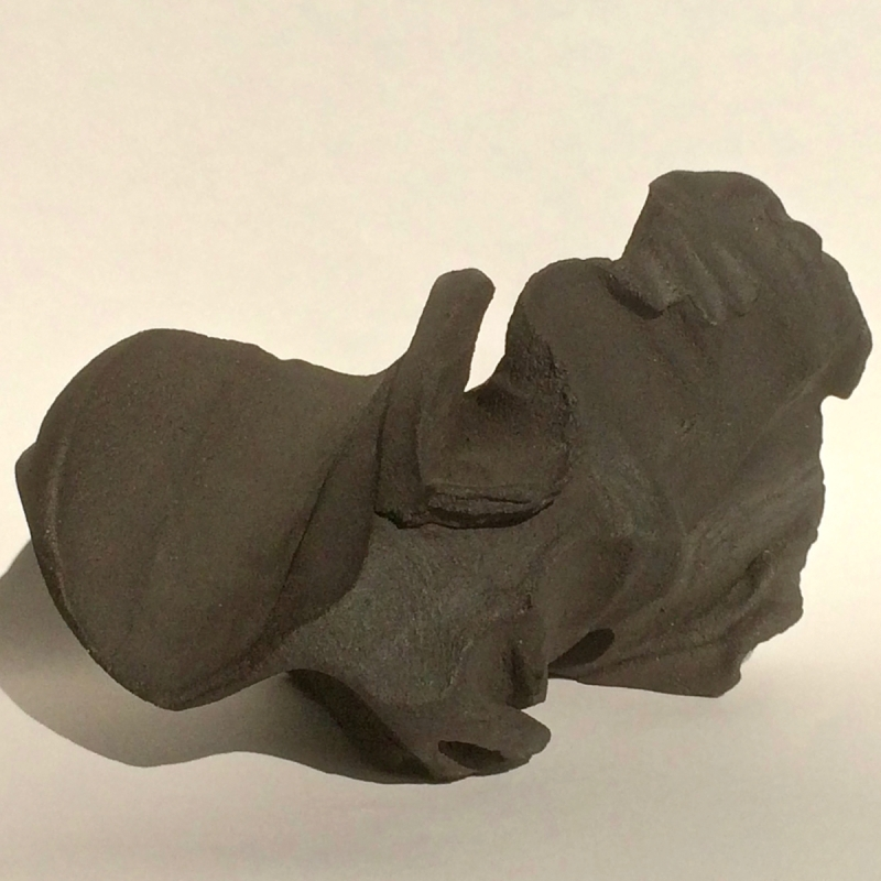 Black Clay form shaped by rhythmical beating and fired to stoneware.
