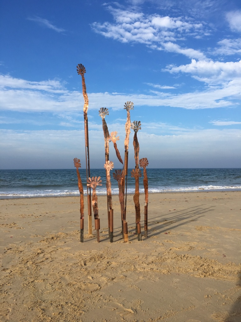 Copper Mimi figures Installation at Happisburgh Beach.
